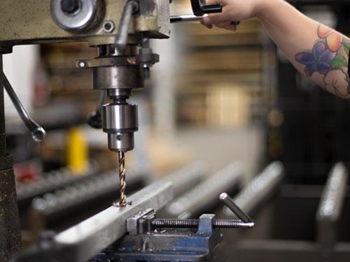 Drilling through metal tube